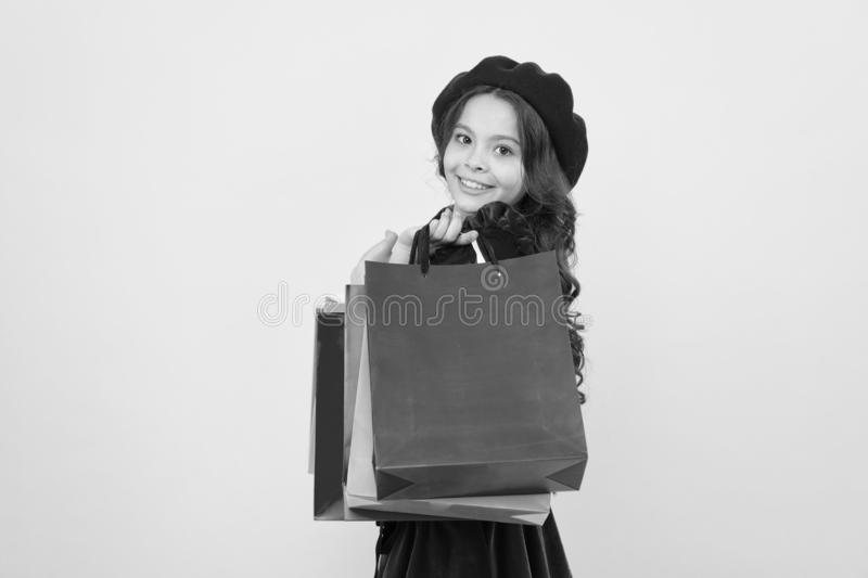 Small girl child with shopping bags. Birthday and christmas presents. International childrens day. big sale in shopping. Mall. Happy shopping online. Pleasant stock image