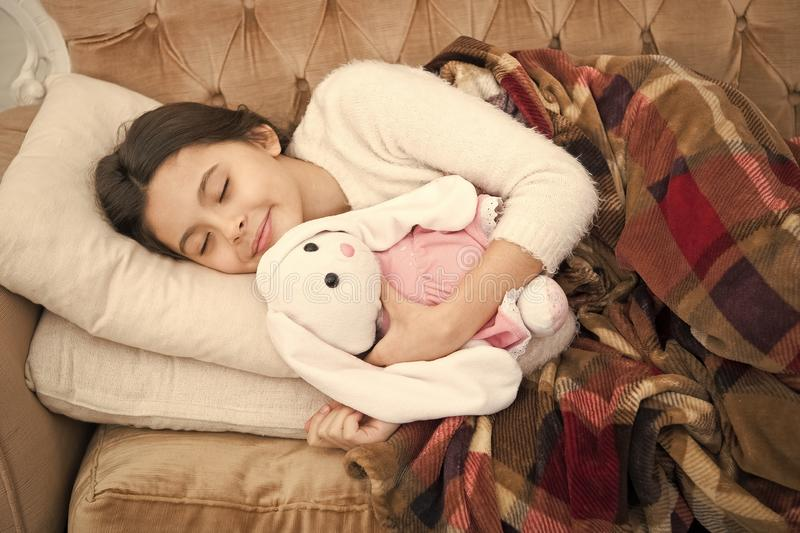 Small girl child. Sweet dreams. happy little girl sleep in bed. family and love. childrens day. Childhood happiness. Good night. Good morning. Child care royalty free stock images