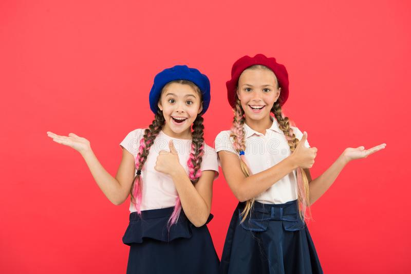 Small girl children with perfect hair. Childhood happiness. Friendship and sisterhood. childrens day. Back to school. Small kid fashion. Happy little sisters royalty free stock photo