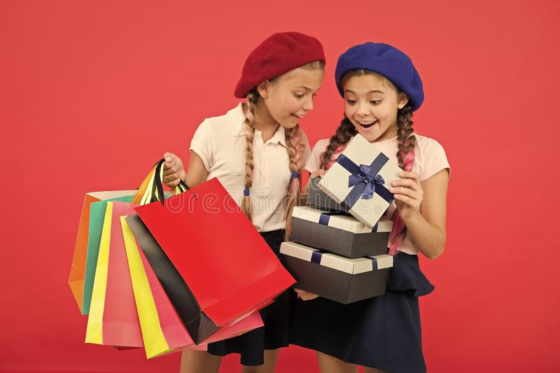 Small girl children with shopping bags. friendship and sisterhood. Birthday and christmas presents. International. Childrens day. big sale in shopping mall stock photos
