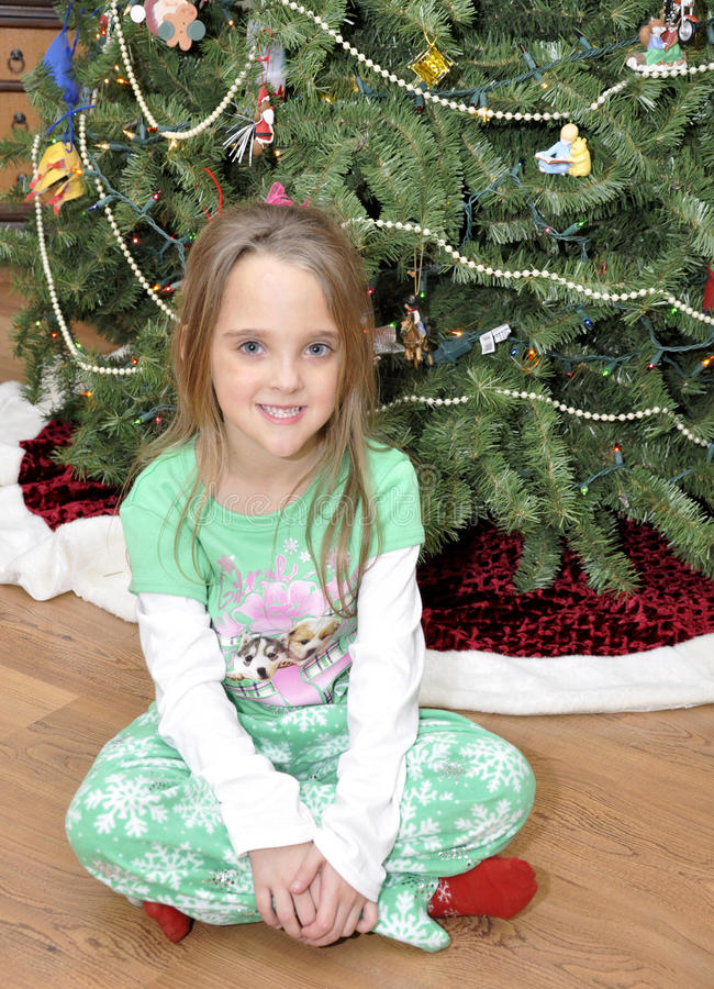 Download Small Girl By Christmas Tree Royalty Free Stock Image - Image: 17582336