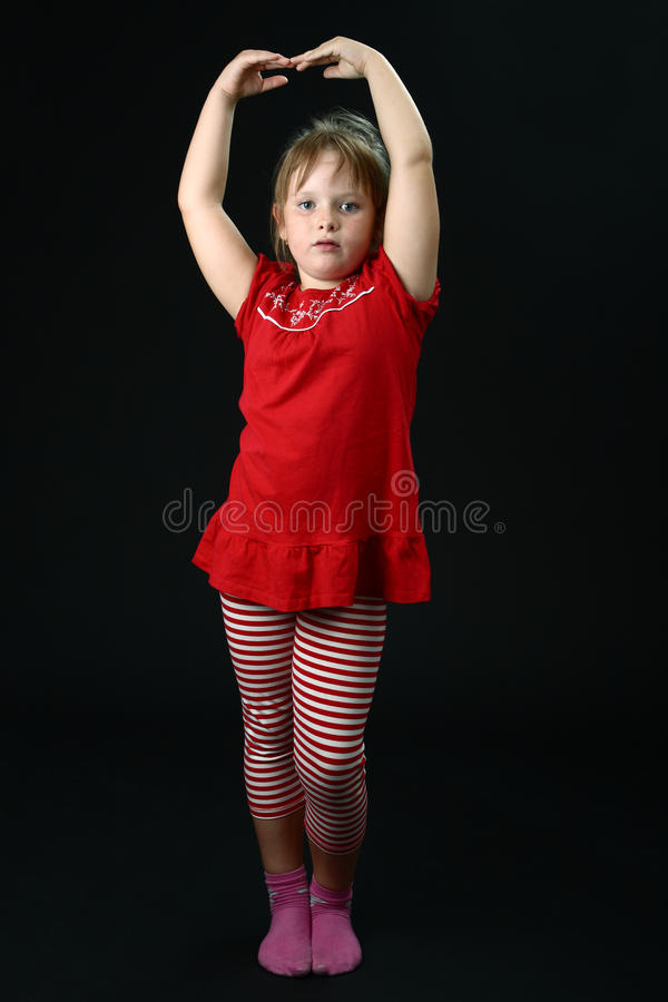 Download Small Girl Dancing In Red Casual Clothes On Black Stock Photo - Image of freckles, childhood: 16129864