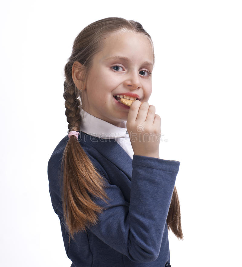 Download Small girl eating cookies stock photo. Image of holding - 29085858