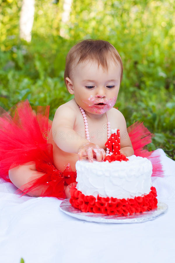 Small Girl Eating Her First Birthday Cake Stock Image Image of
