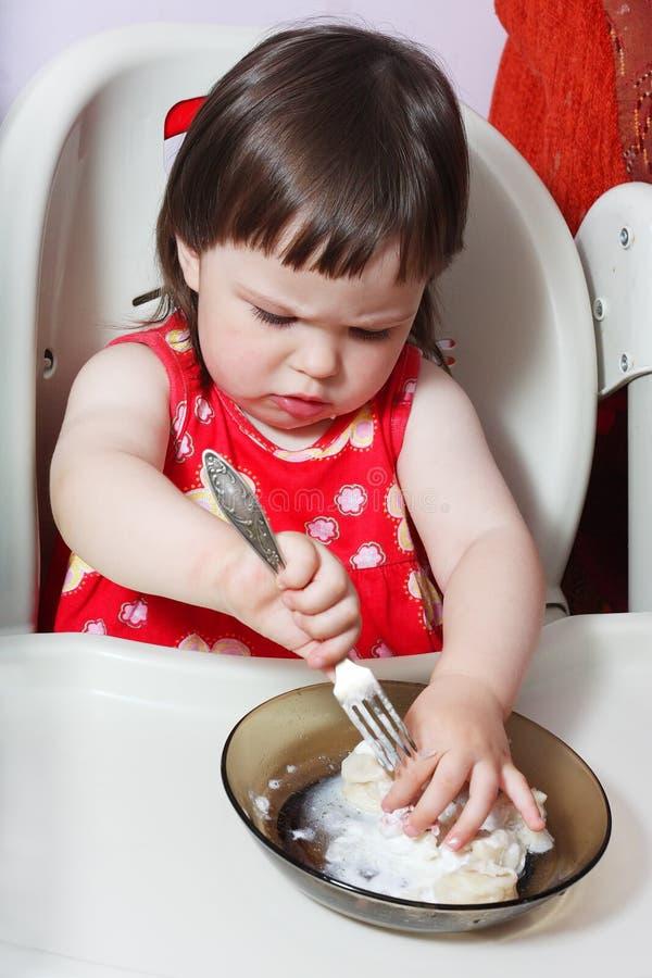 Small girl eats dumplings royalty free stock photo
