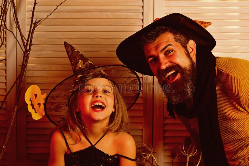 Small girl and father happy smiling on halloween. Happy family celebrate halloween. Happy father and small girl enjoy. Halloween party. We all go a little mad stock photo