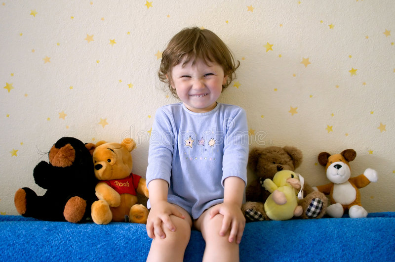 Small girl with funny smile royalty free stock image