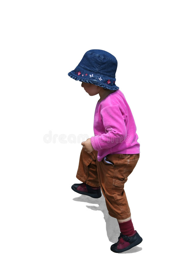 Small girl is going upstairs stock photos
