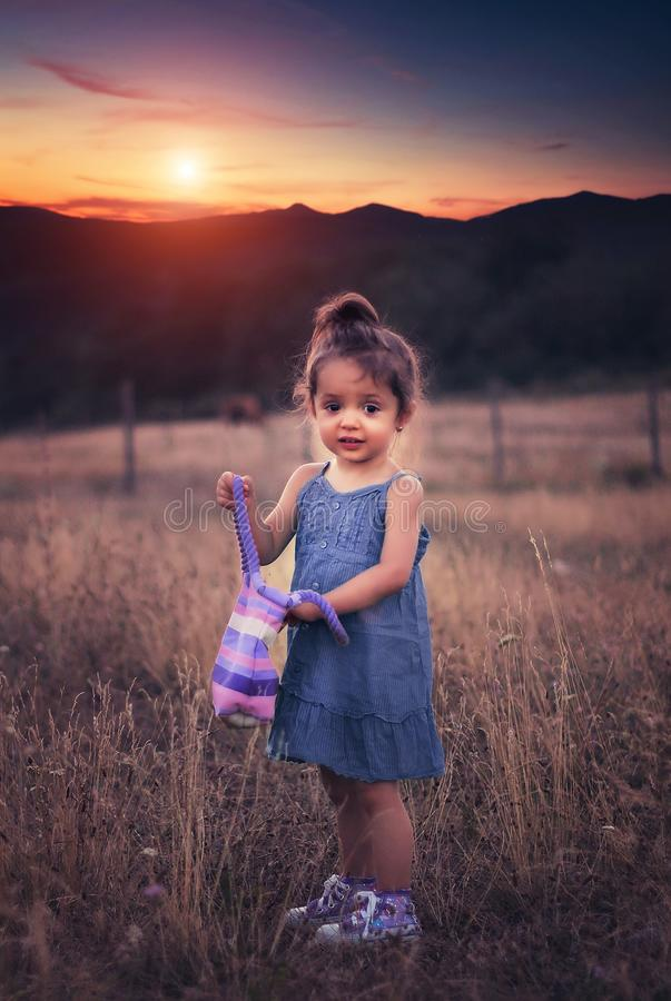 Small girl on grassy field stock photos