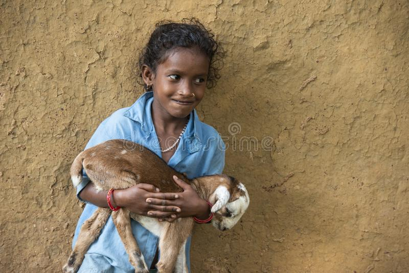 Small girl holding goat in hand in nangur Village near Jagdalpur,Chhattisgarh,India. Asia royalty free stock photo