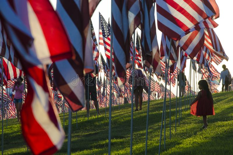 Small girl and US Flag monument of 11th September in Malibu. Small girl between Hundreds of United States of America Flags in Malibu, California to honor victims royalty free stock photos