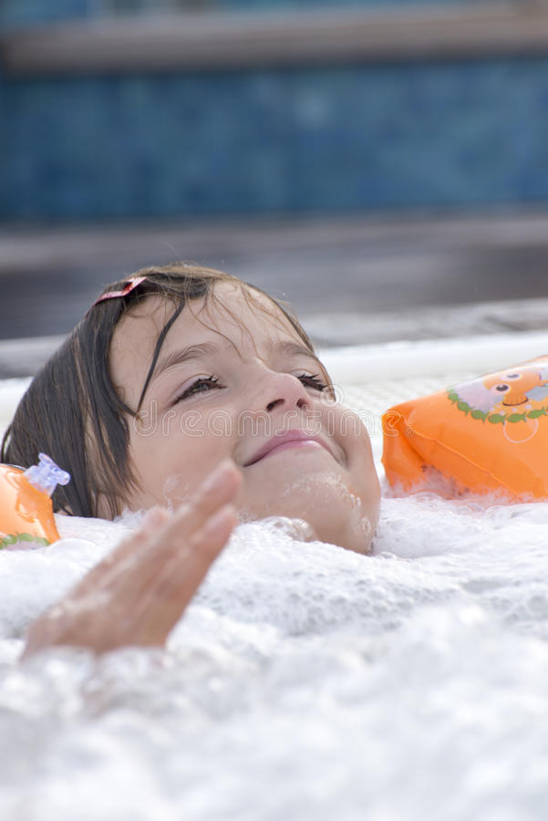 Small girl in jacuzzi royalty free stock photo