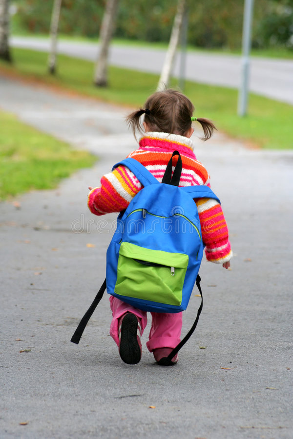 Small girl large backpack royalty free stock photo