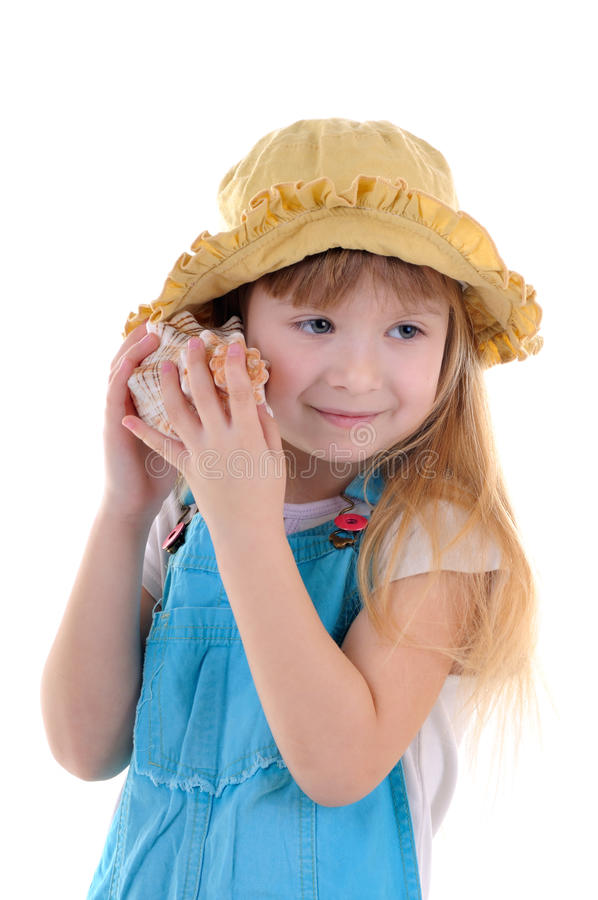 Download Small Girl Listens A Sea Shell Stock Photo - Image of shell, romper: 14871760