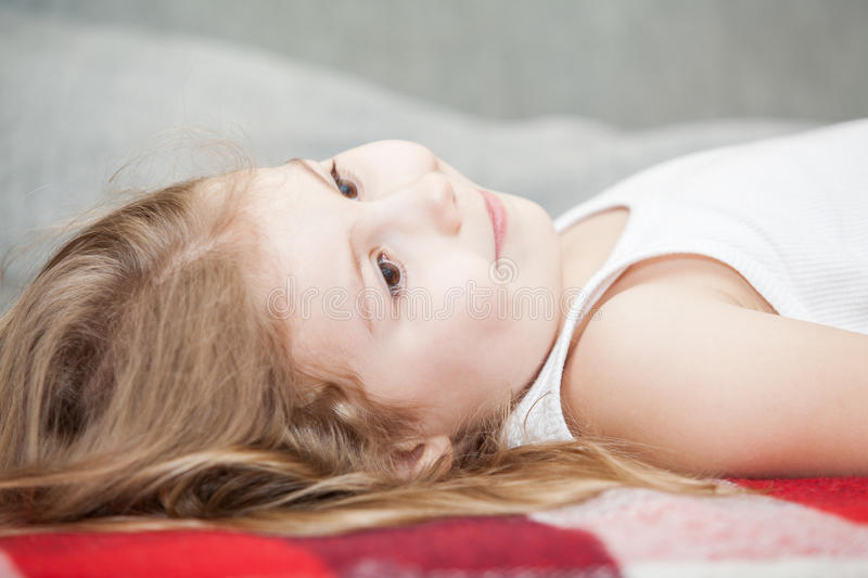 Small Girl Lying On A Pillow Royalty Free Stock Image