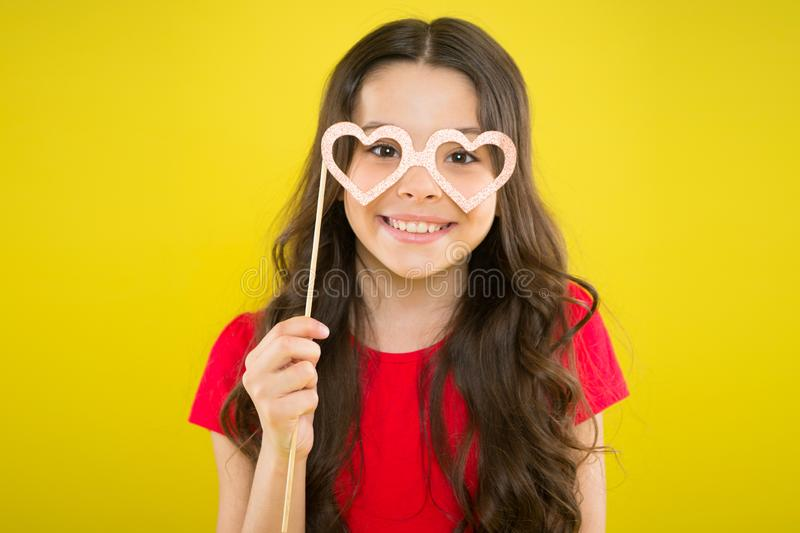 Small girl with party glasses. small girl hold funny glasses. happy birthday. party elements. child ready for party. Prepare for party. happy girl on yellow royalty free stock image