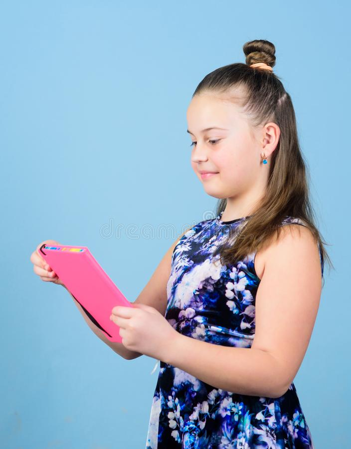 Small girl with pink note book. school child with album for painting. drawing in album paper. scrapbook for diy art. School diary for making notes. workbooks royalty free stock photography