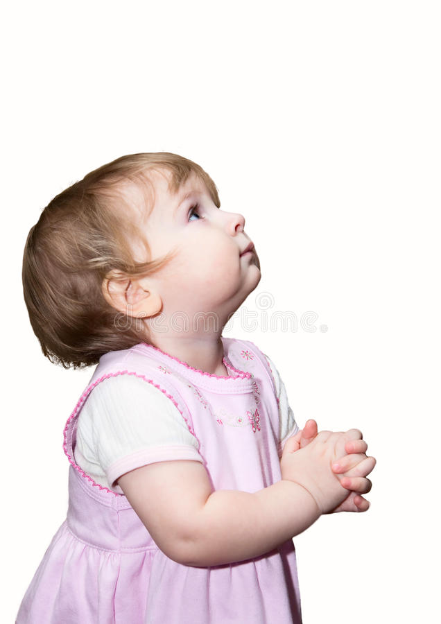 Small girl praying with hands together royalty free stock images