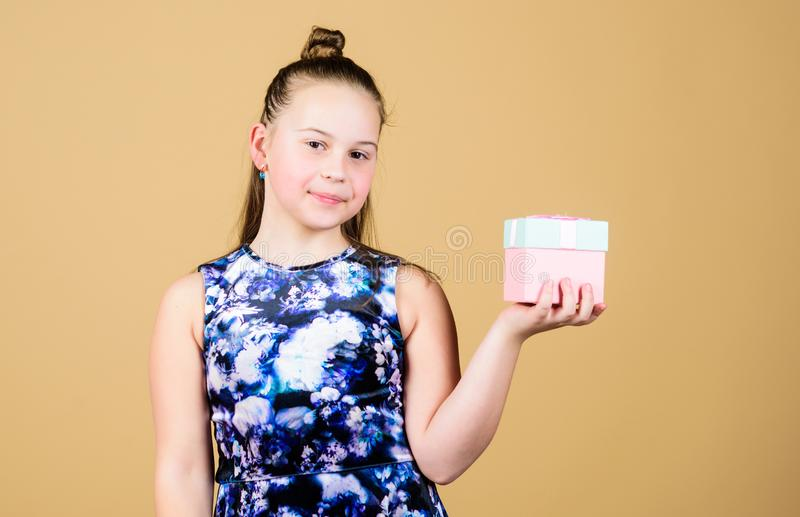 Small girl with present box. Happy birthday. Holiday celebration. Boxing day. Christmas shopping. Surprise. Childrens. Day. Congratulation. Cheerful child stock image