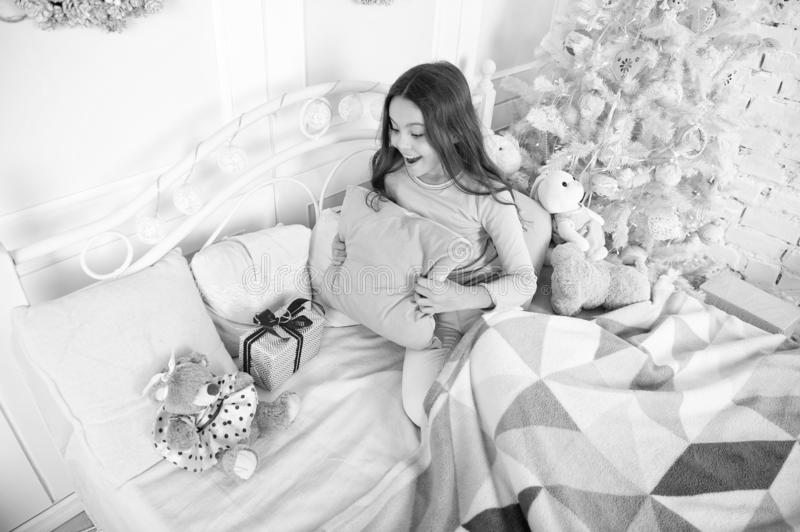 Small girl relax at home. christmas family holiday. happy new year. Christmas shopping. little child girl with xmas. Present. The morning before Xmas. Sleep royalty free stock images