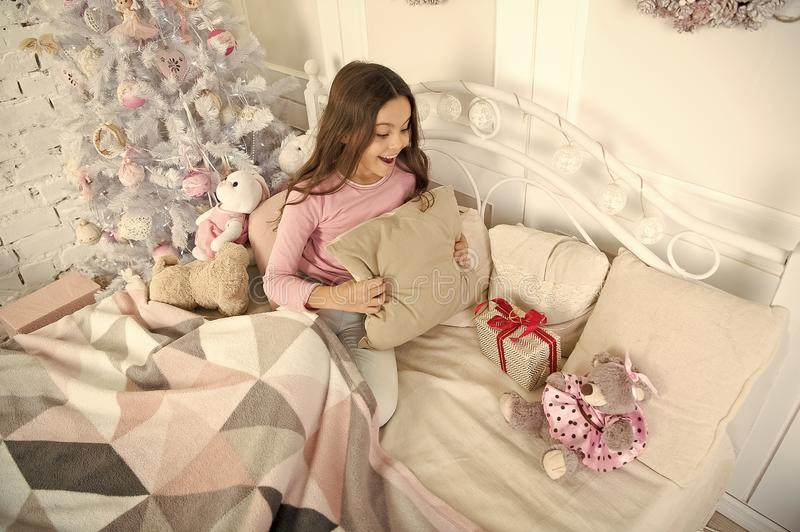 Small girl relax at home. christmas family holiday. happy new year. Christmas shopping. little child girl with xmas. Present. The morning before Xmas. Sleep stock image