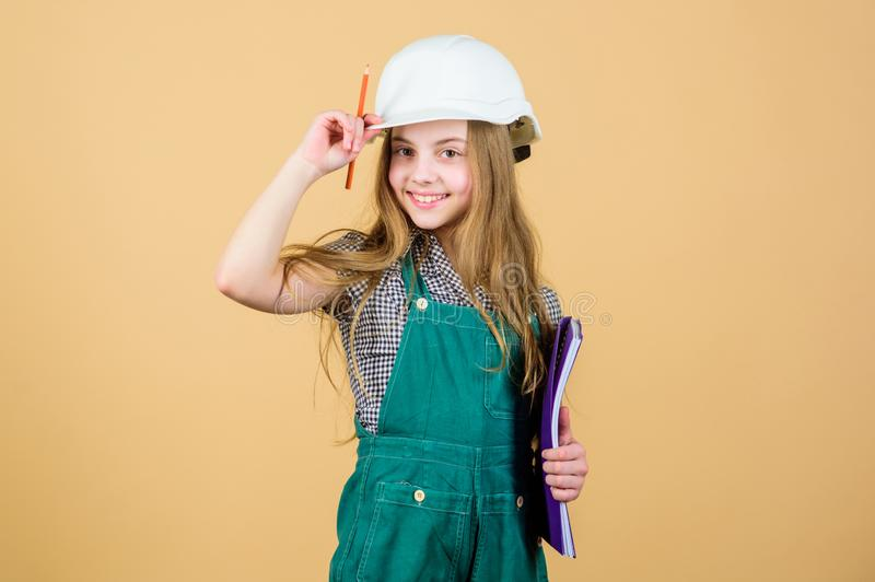 Small girl repairing in workshop. Foreman inspector. Repair. Child care development. Safety expert. Future profession. Builder engineer architect. Kid worker royalty free stock photo