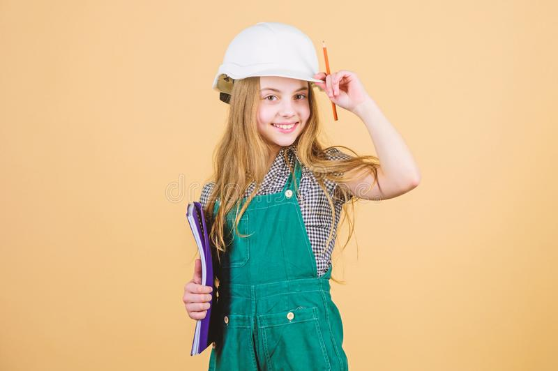Small girl repairing in workshop. Foreman inspector. Repair. Child care development. Safety expert. Future profession. Builder engineer architect. Kid worker royalty free stock photography