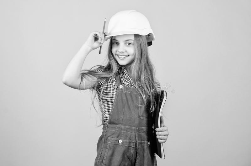 Small girl repairing in workshop. Foreman inspector. Repair. Child care development. Safety expert. Future profession. Builder engineer architect. Kid worker stock images