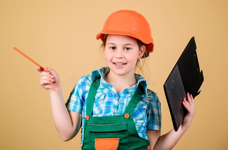 Small girl repairing in workshop. Foreman inspector. Repair. Safety expert. Future profession. Child care development. Builder engineer architect. Kid worker royalty free stock images