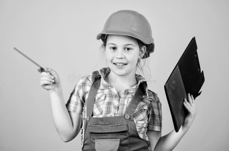 Small girl repairing in workshop. Foreman inspector. Repair. Safety expert. Future profession. Child care development. Builder engineer architect. Kid worker stock images