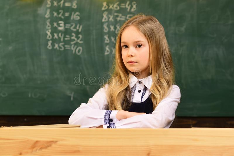 Small girl. small girl with serious face in school. small girl at school lesson. small girl is ready to study. happy stock photography