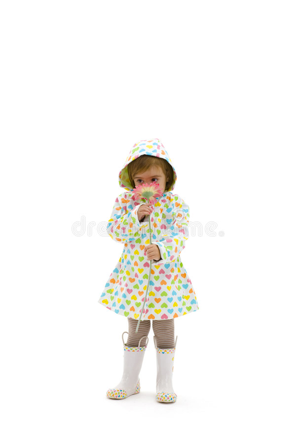 Small girl smelling flower royalty free stock photos