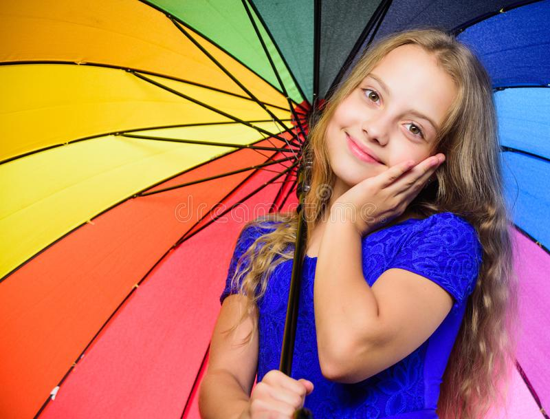 Small girl with umbrella in rainy weather. Happy little girl with umbrella. Feeling protected at this autumn day. Happy stock image