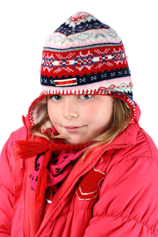 Small girl in winter clothes and knitted ears cap