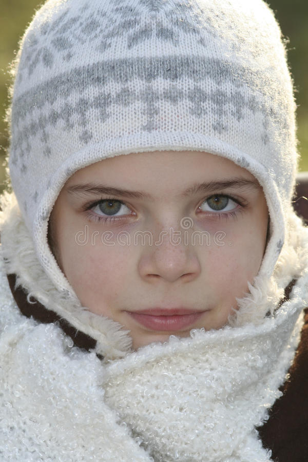 Small girl in winter clothes stock image