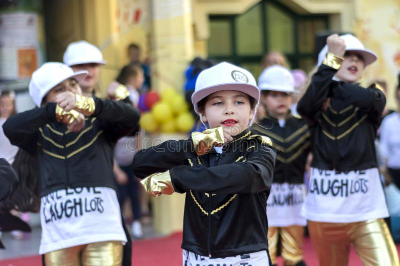 Small girls in black and gold clothes dancing for world dance day stock photography
