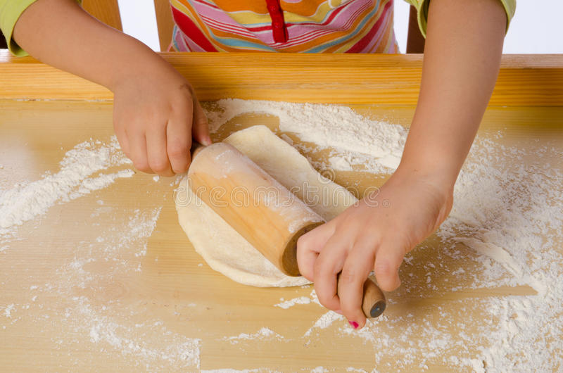 Small girls in cook stock image