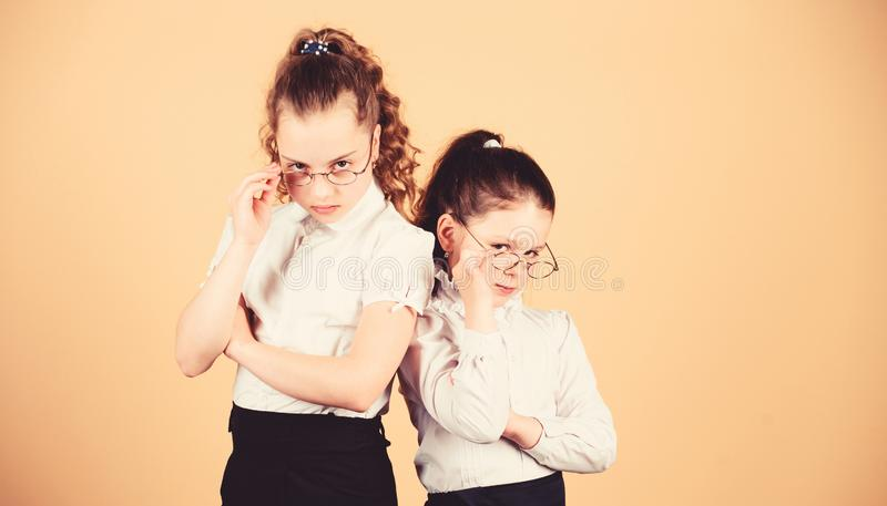 Small girls in school uniform. confident students. friendship forever. back to school. study concept. smart small girls. At lesson. Homeschooling concept stock photos