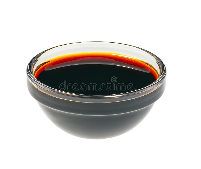 Soy sauce in glass bowl isolated on white background stock images