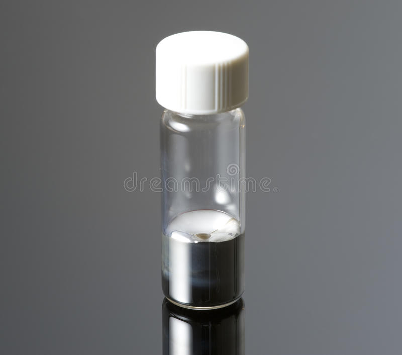 A small glass container containing mercury. royalty free stock image