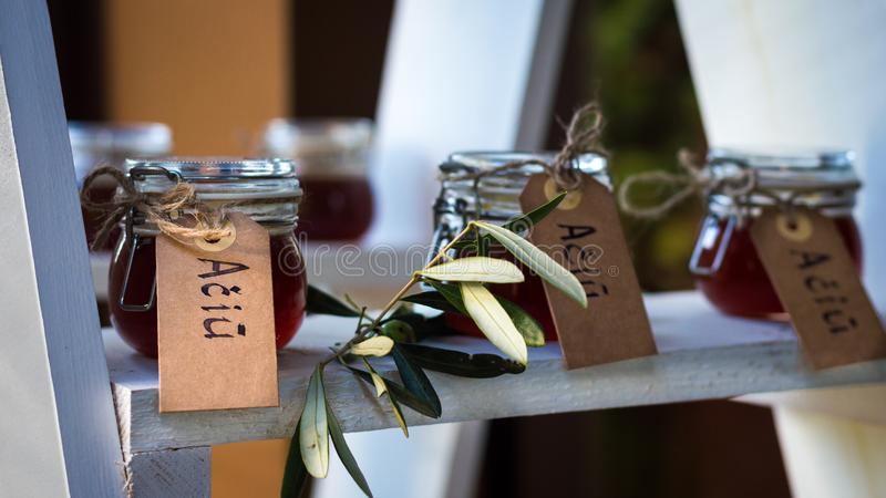 Small glass jars filled with honey stock image