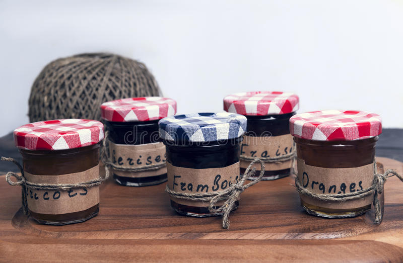 Small glass jars with lids fruit or berry jam royalty free stock image