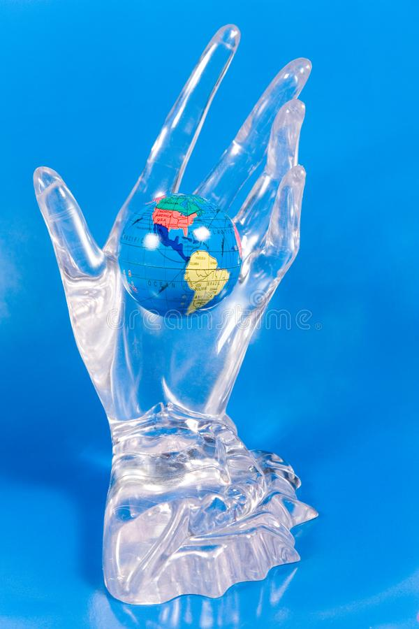 Download Small Globe In A Glass Hand Stock Image - Image of glass, symbolize: 7896509