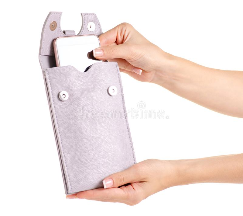 Small gray female bag case for mobile phone smartphone in hand royalty free stock images