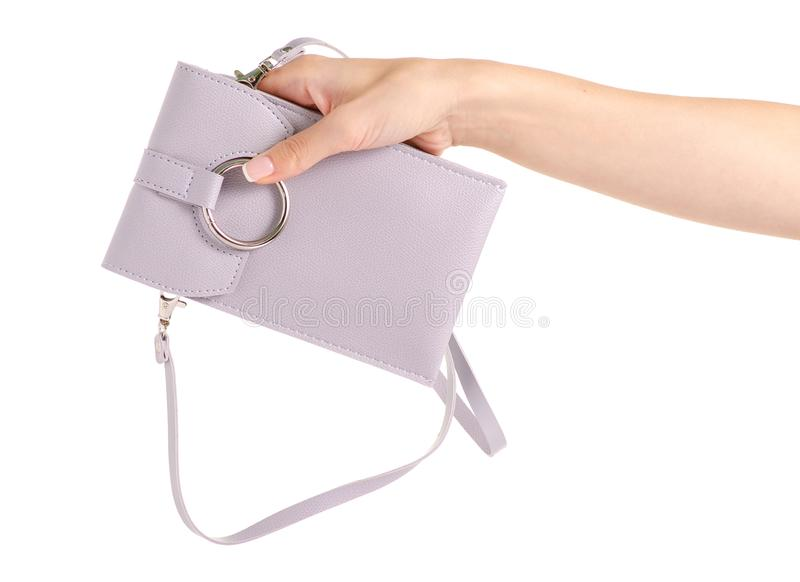 Small gray female bag case for mobile phone smartphone in hand stock photos