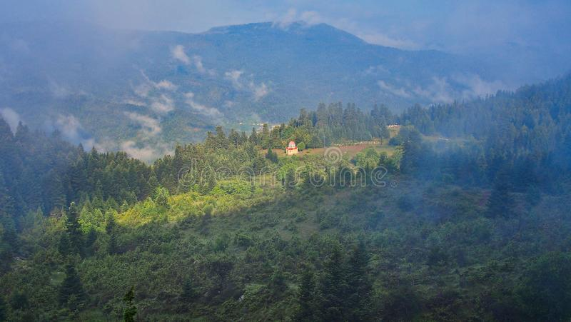 Small Greek Orthodox Church on Foggy Mountain Side, Greece royalty free stock photography