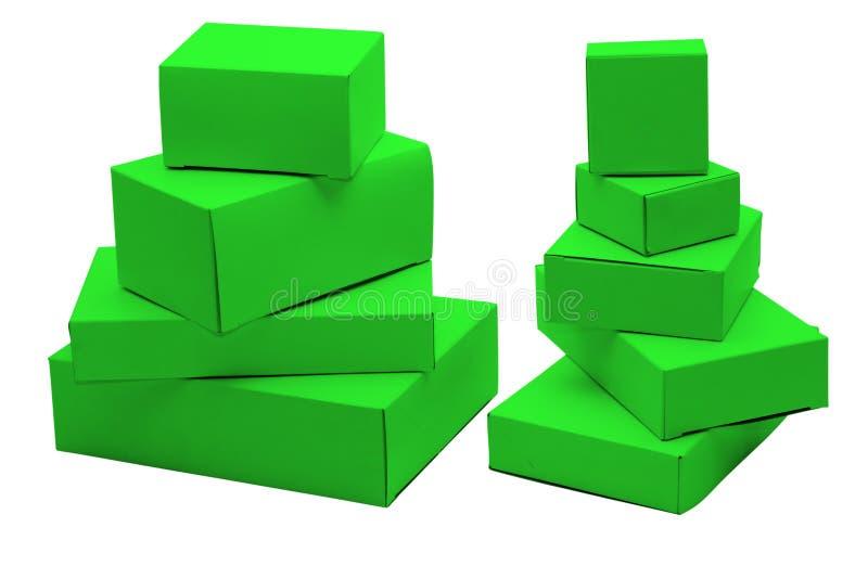 Small green cardboard boxes stock photos