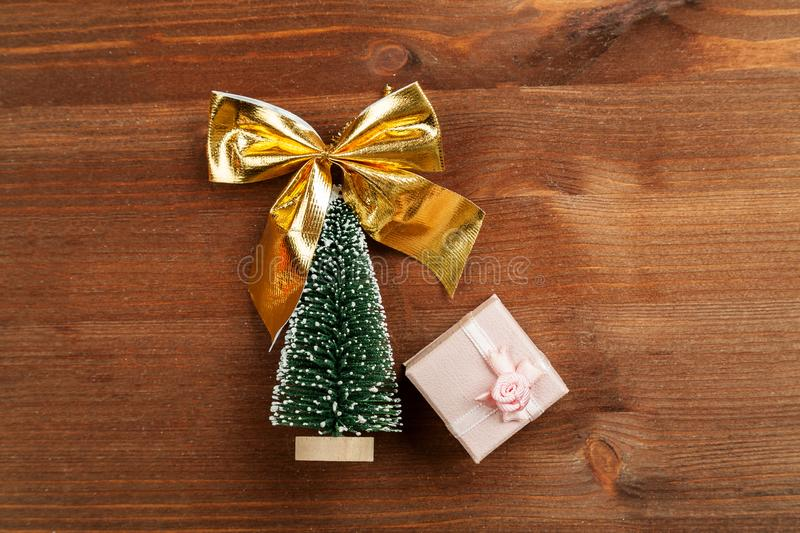 Small green christmas tree with pink gift box top view.  royalty free stock photo