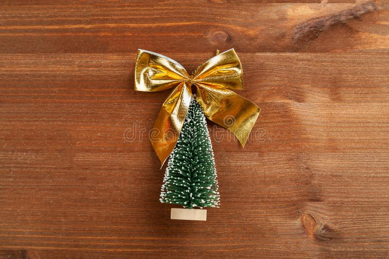Small green christmas tree on a wooden table top view.  royalty free stock photos