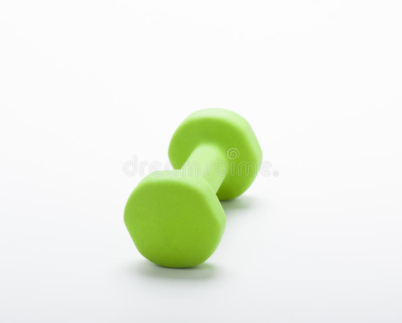 Small green dumbbell,. In white background royalty free stock photos